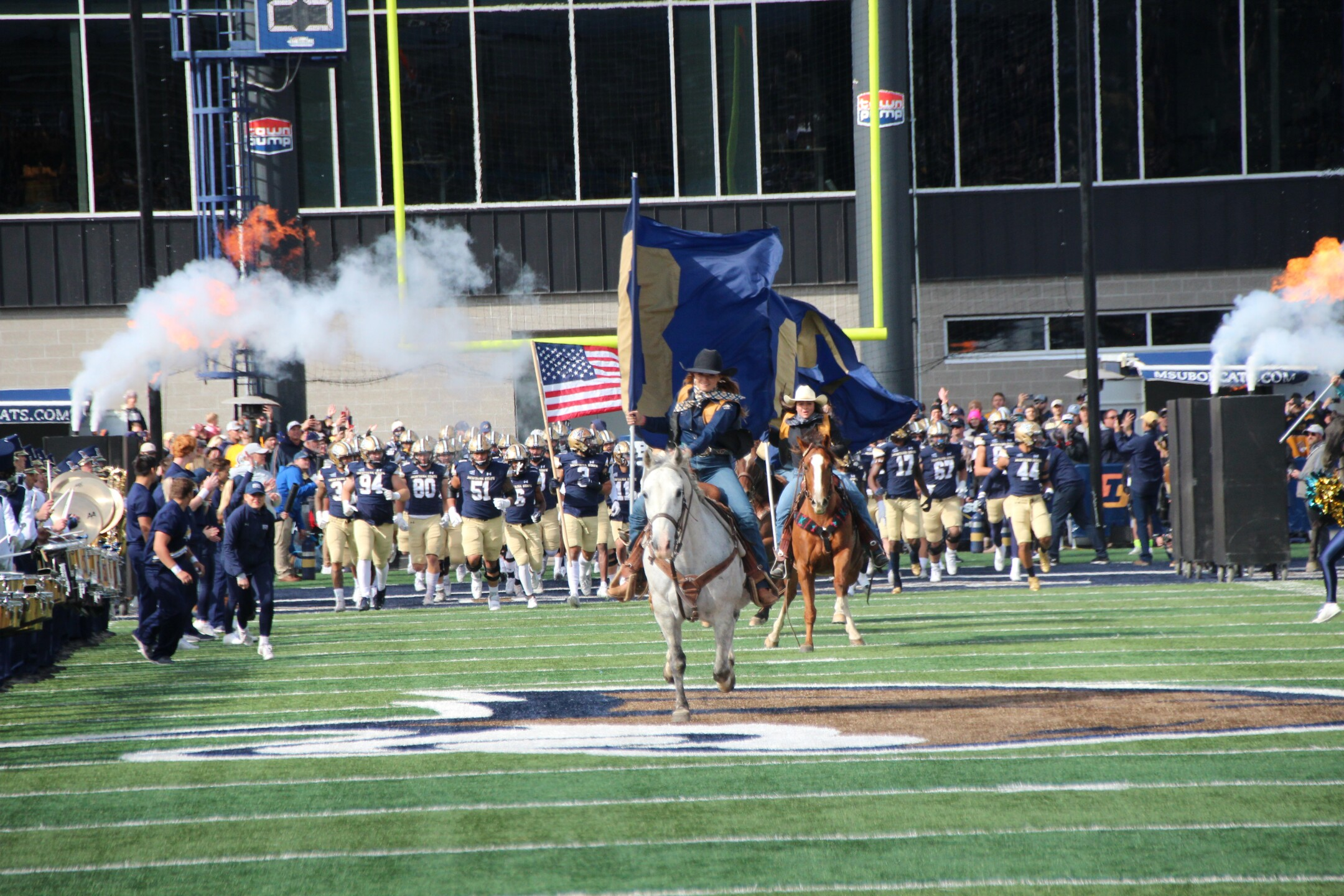 Montana State rodeo team rides in to start the game