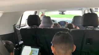 kids learning in car