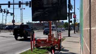 hacked construction sign.jpg