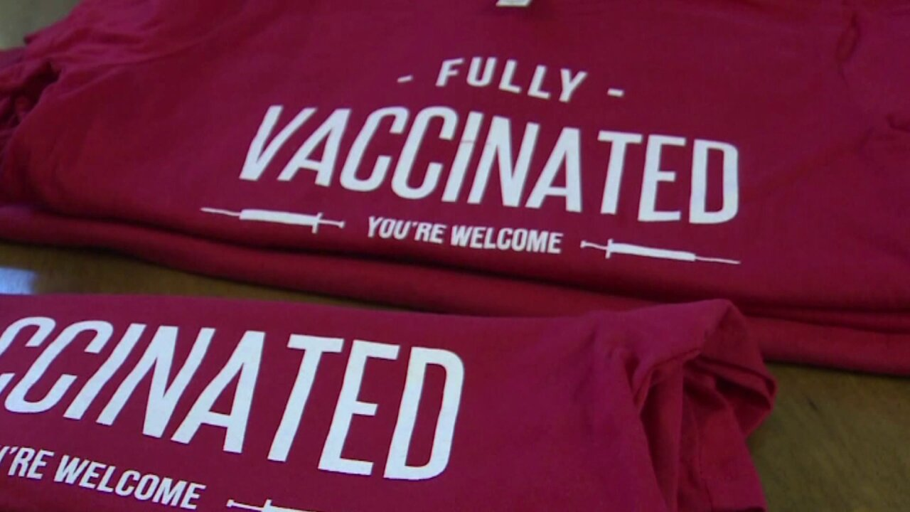 Shirt reads: 'Fully vaccinated. You're welcome'
