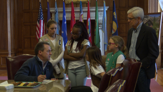 Girl scouts pitch to Governor Bullock why he should buy cookies