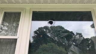 Bullet through window in Joppa.