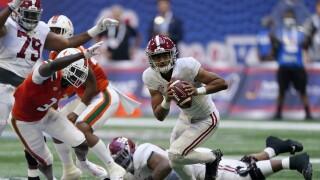 Alabama Crimson Tide QB Bryce Young eludes Miami Hurricanes safety Gilbert Frierson in Atlanta in 2021