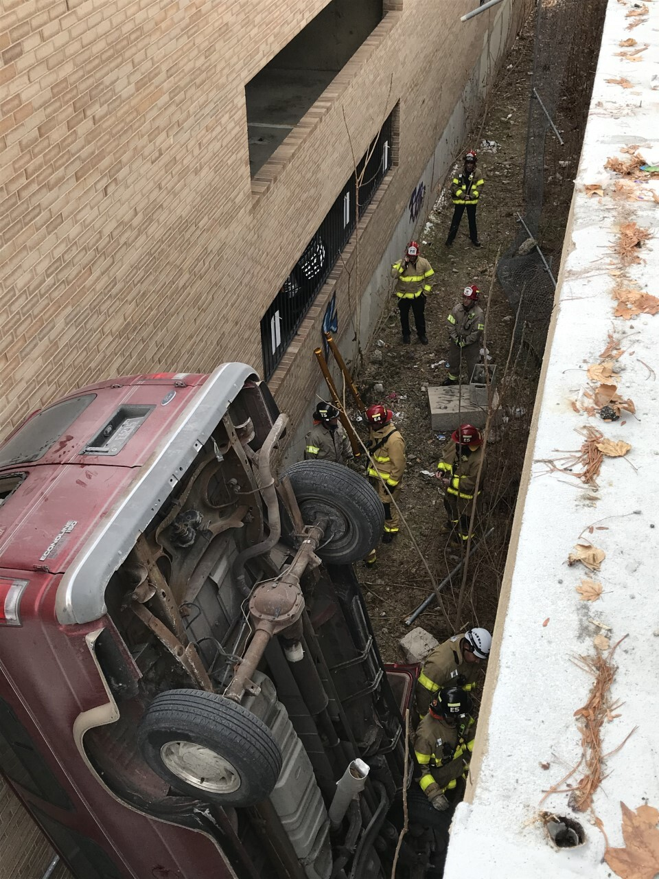 Photos: Man drives van off top of 2-story parking garage in Salt LakeCity