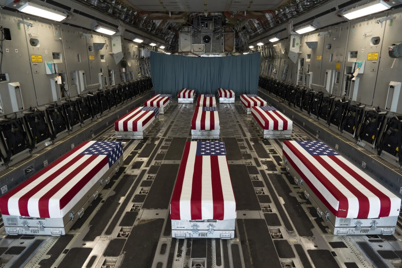 flag-draped caskets of soldiers killed in Afghanistan inside transport plane, Aug. 29, 2021