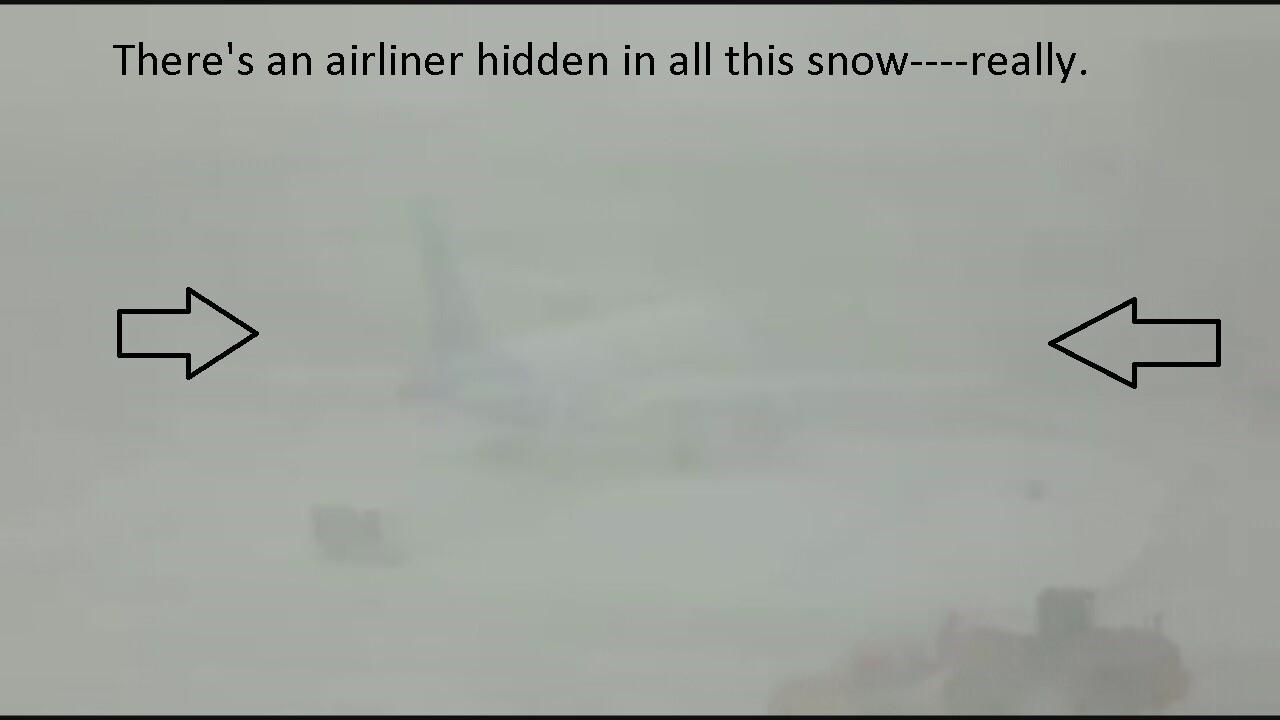 2019-03-13-travel disruption-snowy plane--arrows.jpg
