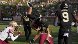 Wake Forest Demon Deacons QB Sam Hartman leaps into end zone for TD vs. Florida State Seminoles in 2021
