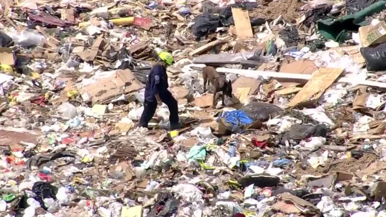 Aurora police searching for possible body in landfill after blood found under dumpster