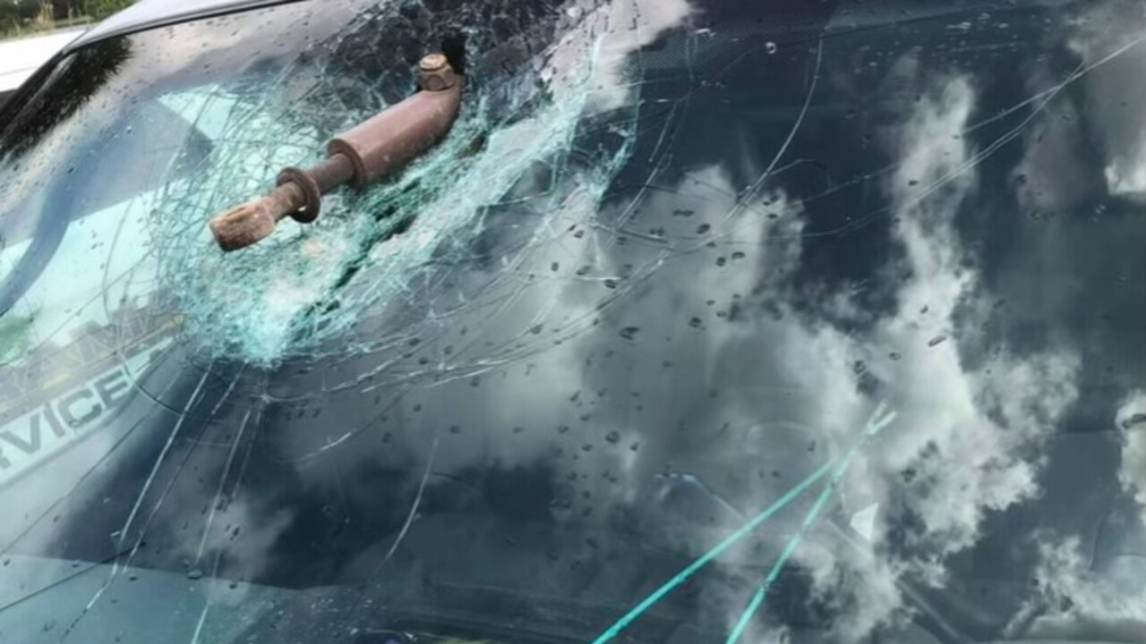 A steel pipe lodged in the windshield of Mike Zelnar's car on July 20, 2021.jpg