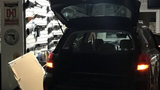 Photo of suspect  vehicle used to  break into gun shop.