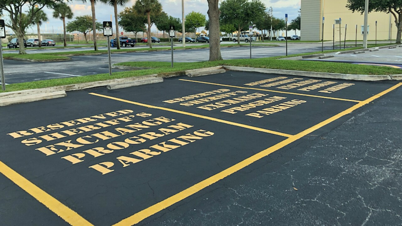 Three reserved parking spaces at the Martin County Sheriff's Office designated for selling and buying items online.