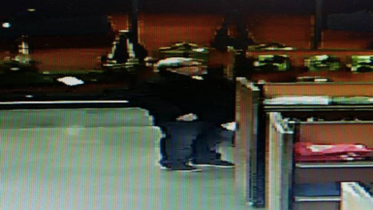 Photos show Kalamazoo murder suspect in gun shop