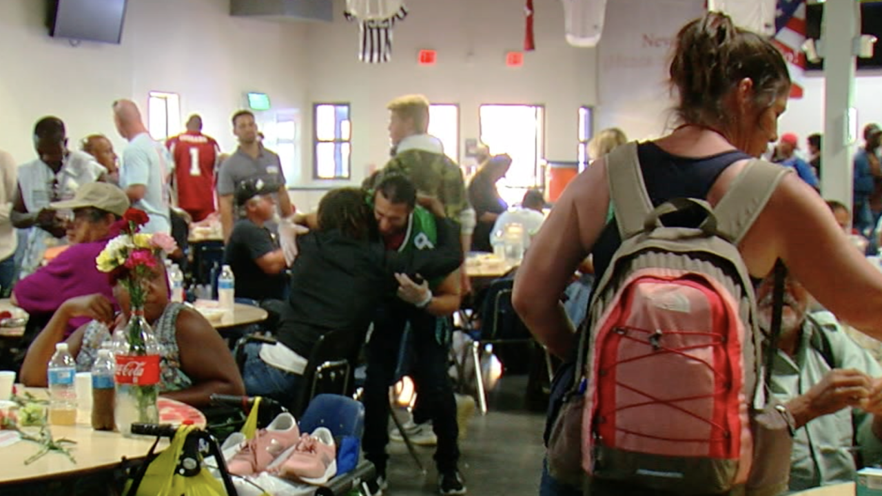 Football players, volunteers serve Easter meals to homeless