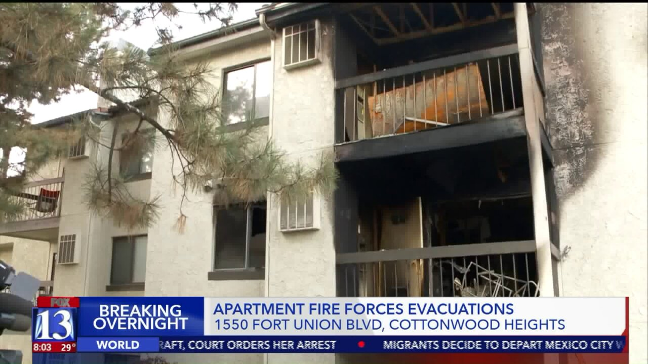 Woman suffers serious respiratory burns in 2-alarm fire in Cottonwood Heights
