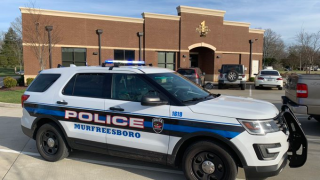 Murfreesboro Police in front of First National Bank.png