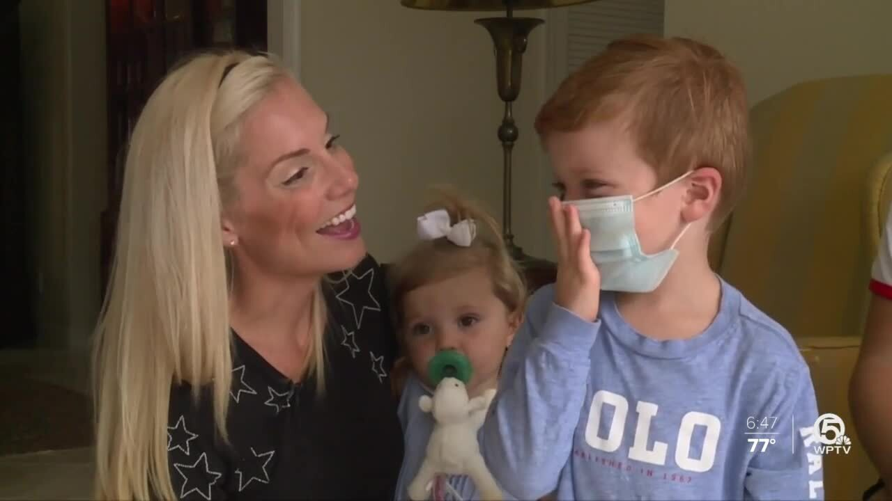 Ariel Bachman and son all smiles about wearing masks