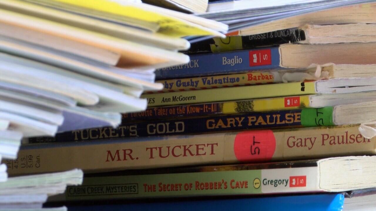 Books stacked up inside Manhattan Elementary school