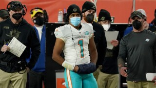 Miami Dolphins QB Tua Tagovailoa watches from sideline after being benched vs. Denver Broncos in 2020