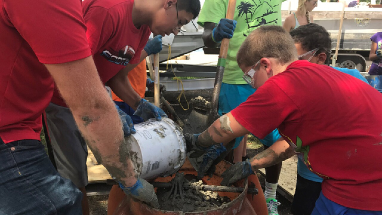 Kids make cement reef balls to help marine life