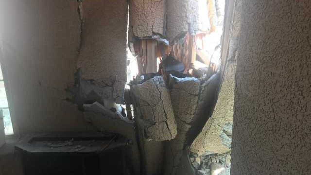 Car smashes into woman's home in North Las Vegas