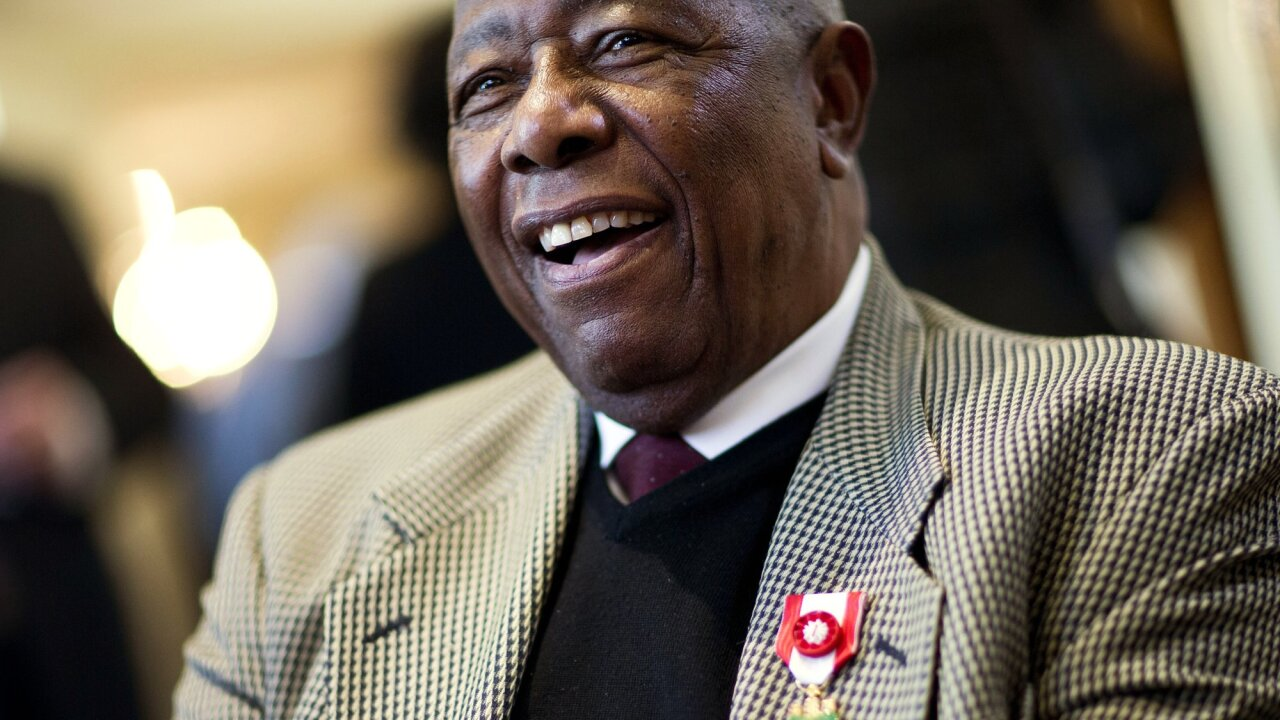 Hank Aaron smiles after being presented with the Order of the Rising Sun, Gold Rays with Rosette by the Consul General of Japan at his official residence Thursday, Jan. 14, 2016, in Atlanta.