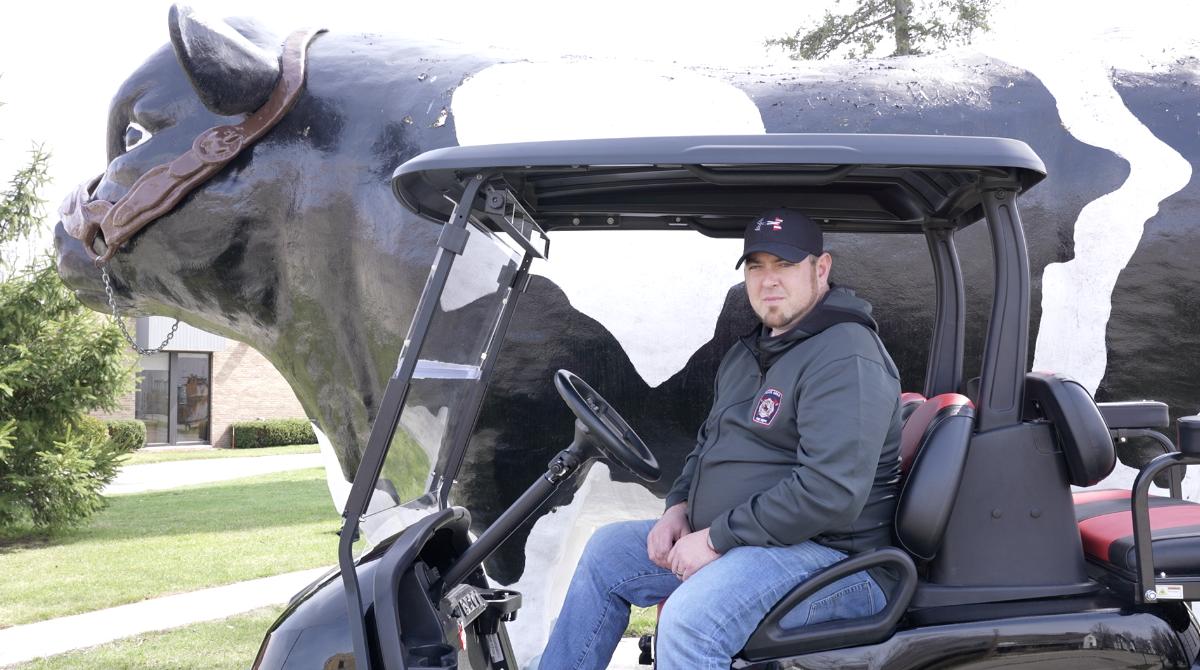 Kory Witt on his golf cart