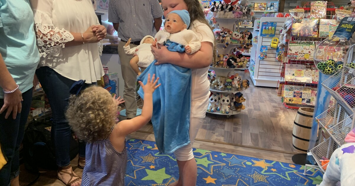 Make A Wish Foundation brings girl baby dolls Nevaeh and Shevaun