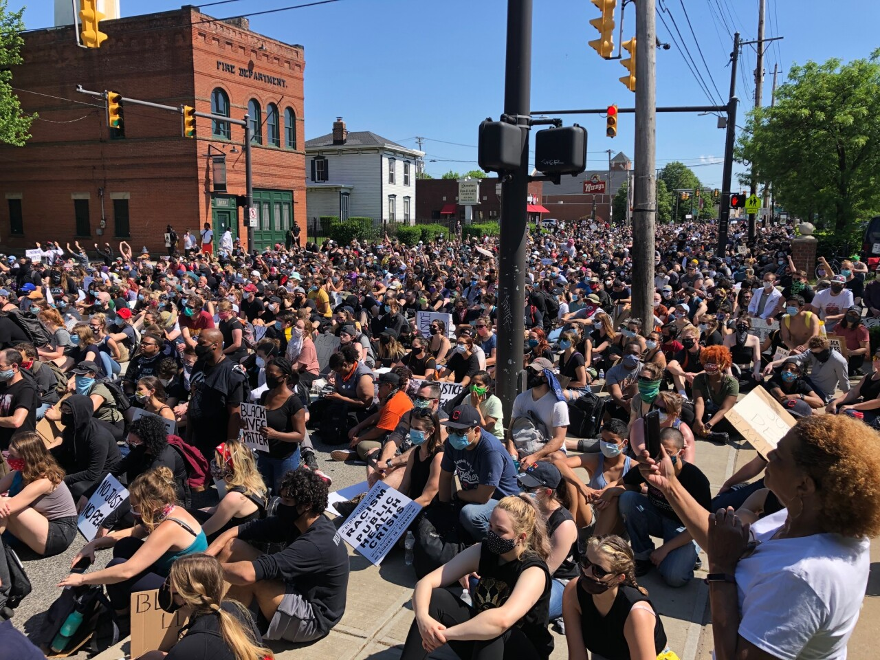 Peaceful protesters sit down on West 25th Street during a weekend demonstration on June 6.