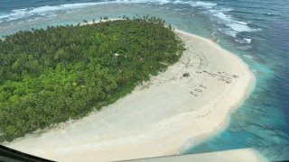 3 mariners rescued from deserted island after writing SOS in sand