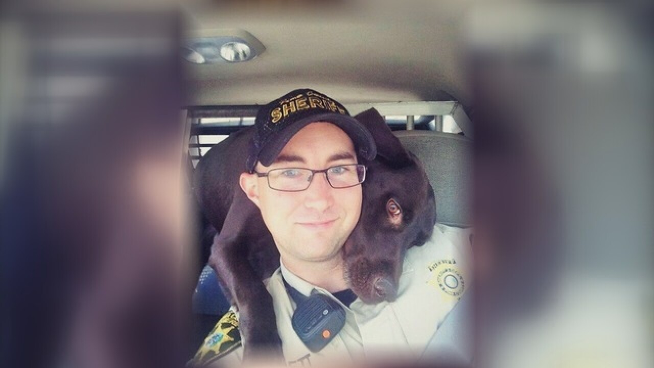 Deputy given hug by K9 partner in viral photo