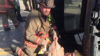 Cincinnati firefighters bring back groceries.jpg