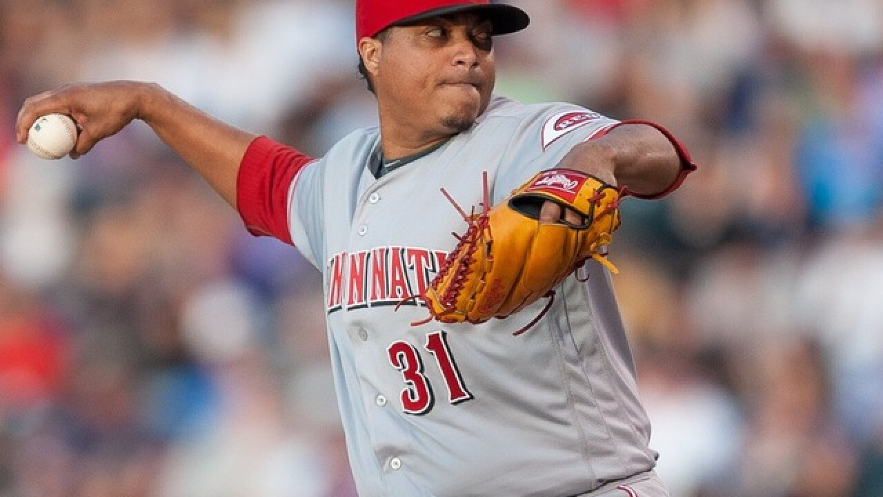 Simon pitches Reds past Rockies 11-4