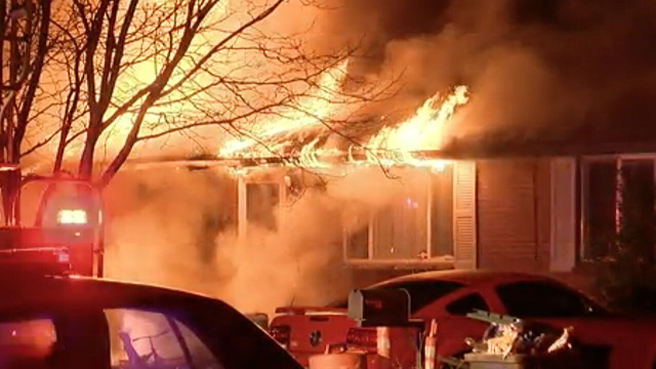 14 people home when duplex catches fire