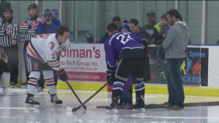 Local hockey team 'pays it forward in purple'