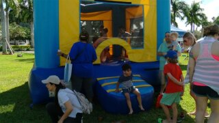 WPTV-bounce-house-at-Day-for-Autism-picnic-in-Wellington-021019.jpg
