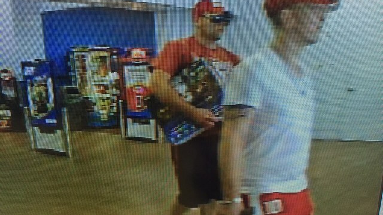 PHOTOS: Two men accused of scamming woman