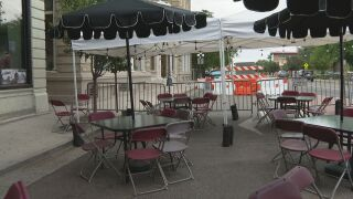 Outdoor seating for customers at The Senate Bar & Grill in Pueblo. The business says it was granted a temporary permit to put seating in the right-of-way on Grand Avenue.