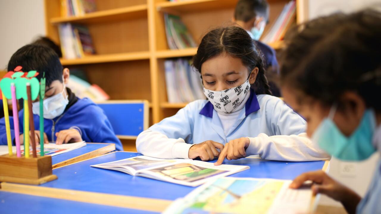 Kids wearing masks in classroom