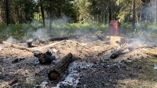 The historic Ford Creek patrol cabin was a total loss when rangers arrived on scene.