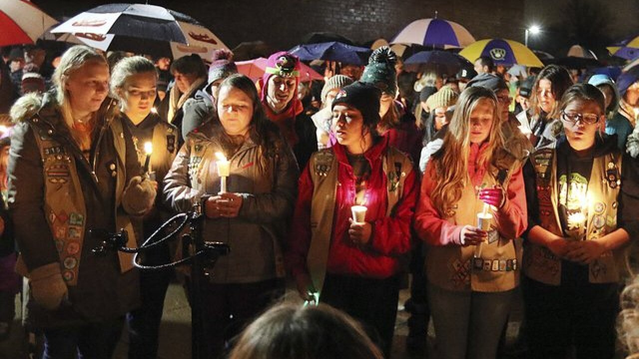 Hundreds gather for vigil for Girl Scouts killed