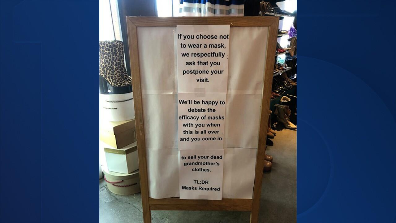 Antique shop's sign goes viral for message about mandating masks
