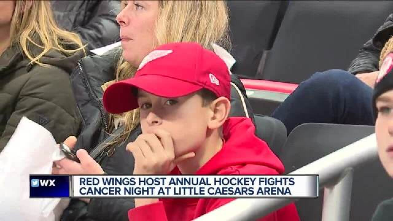 Young cancer survivor skates with Red Wings on Hockey Fights Cancer night