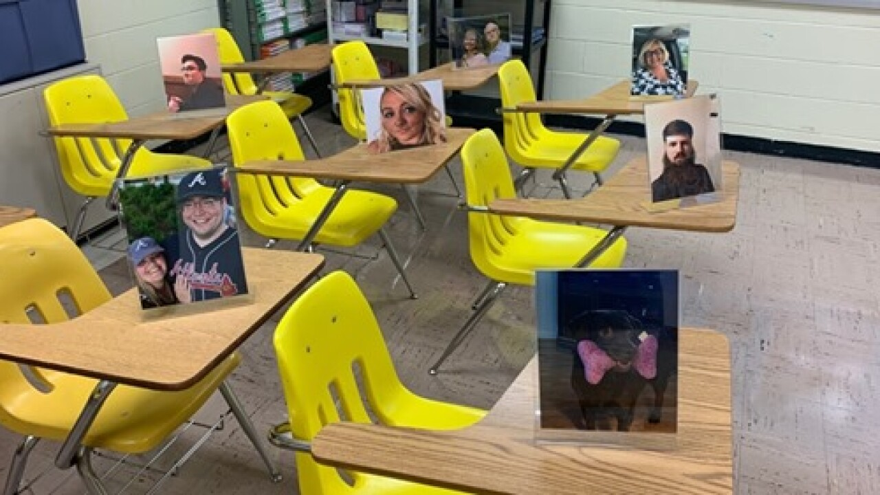 Virginia teacher filling classroom with photo cutouts of students, alumni and friends