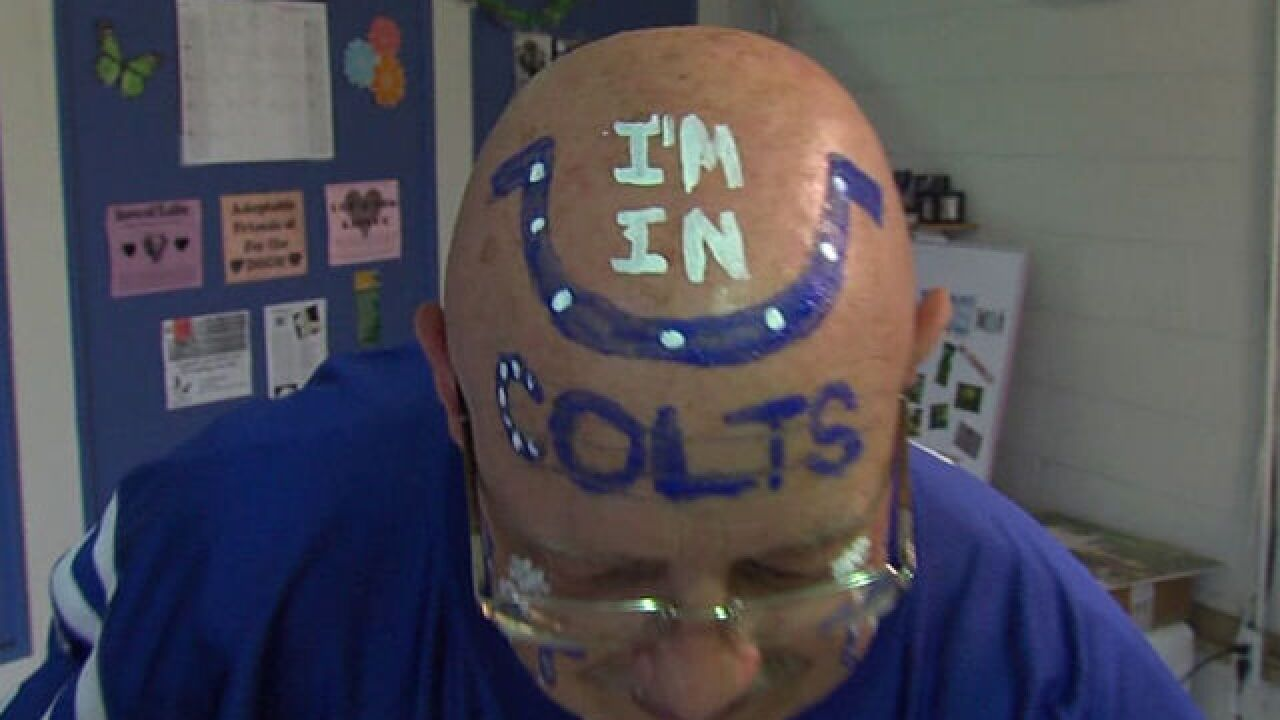 'Tuba guy' combines love of dogs, Colts