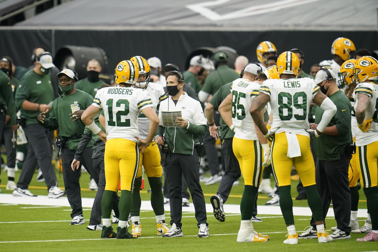 Green Bay Packers head coach Matt LaFleur speaks to QB Aaron Rodgers and team during timeout at Houston Texans in 2020