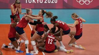 Players from the United States react after defeating Brazil to win the gold medal in women's volleyball at the 2020 Summer Olympics, Sunday, Aug. 8, 2021, in Tokyo, Japan