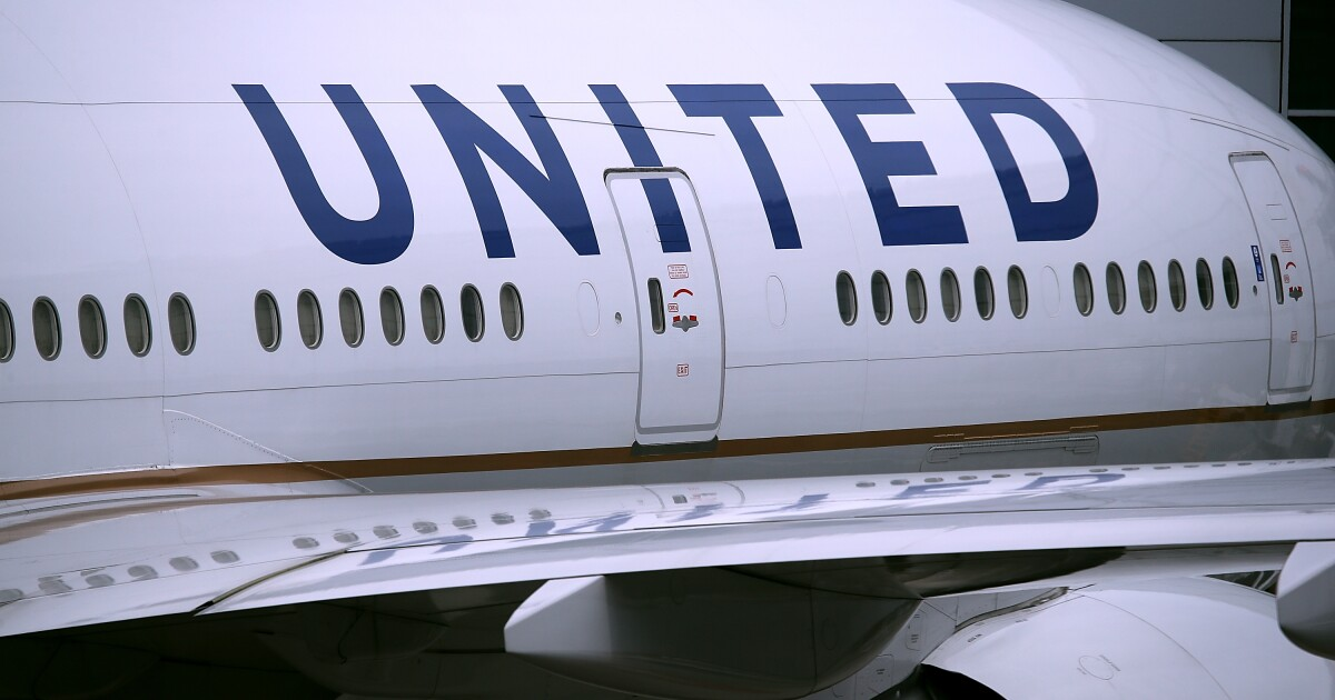 United passenger says he had to sit in vomit-covered seat