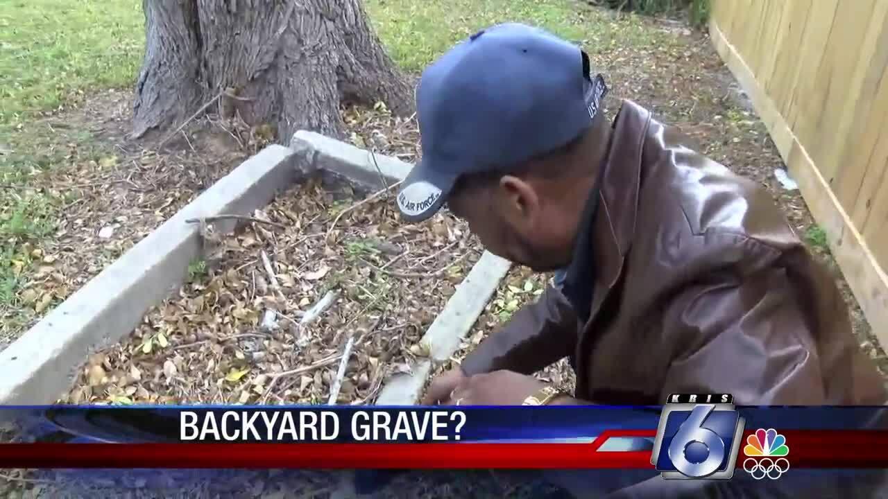 Roy Tyler examines his back yard