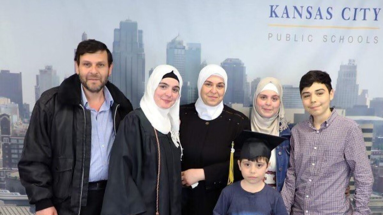 Huda and family after KCPS Middle College graduation at MCC Penn Valley.jpg