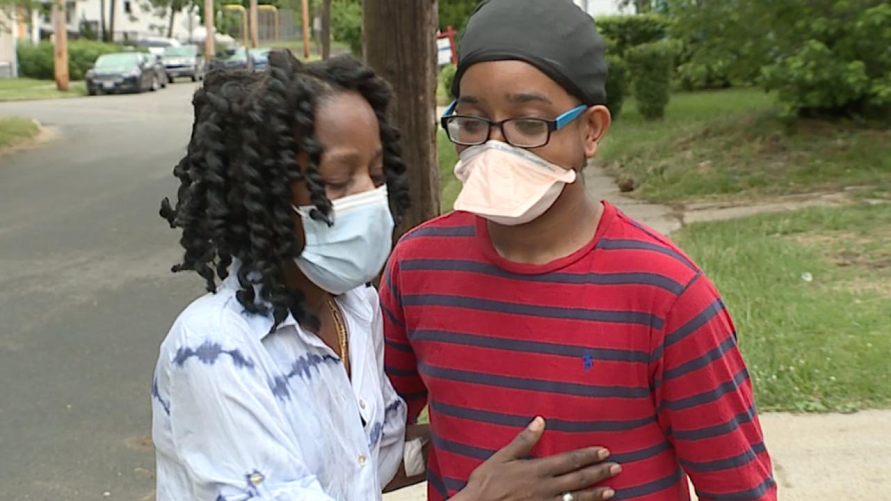 CLE mother demands end to gun violence after bullet grazed her head
